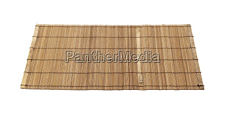 wooden luncheon mat on a white
