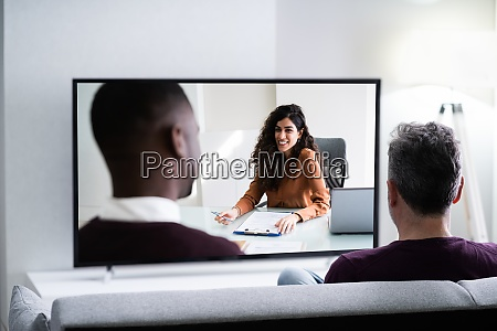 elderly man streaming and watching movie