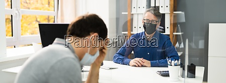 sad man in meeting with consultant