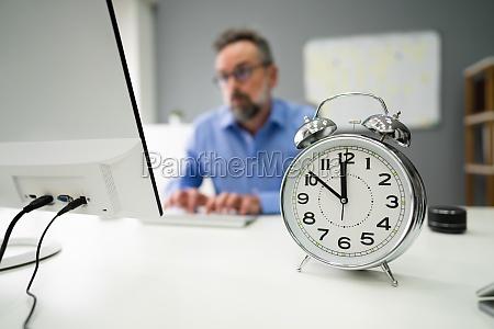 business worker late deadline timer