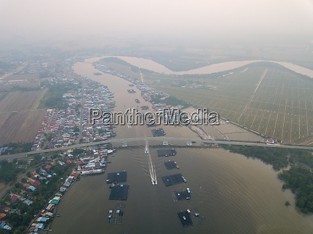 aerial view busy fishing village at