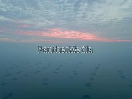 aerial view sunset at fish farm