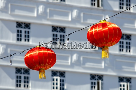 red lantern with colonial building at