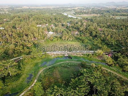 a green path at malays village