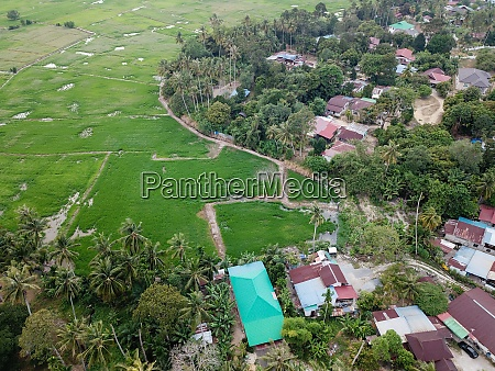 drone view malays kampung beside green