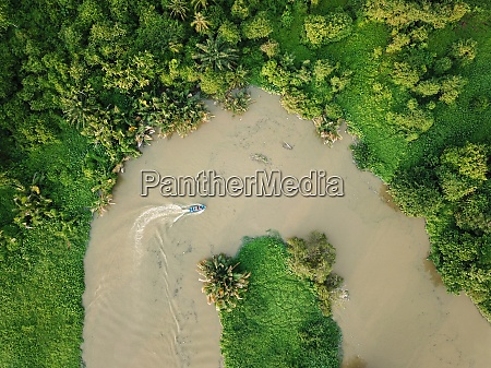 boat at curve river aerial view