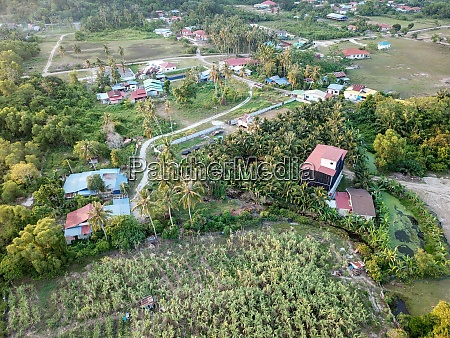 malays village surrounded by green plant