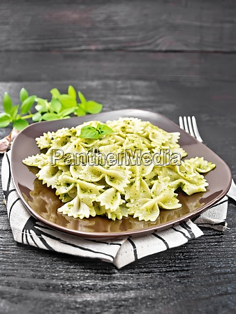 farfalle with pesto in plate on