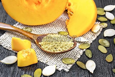 flour pumpkin in spoon on board