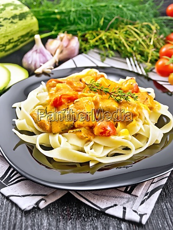pasta with goulash in plate on