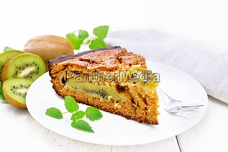pie with kiwi in plate on
