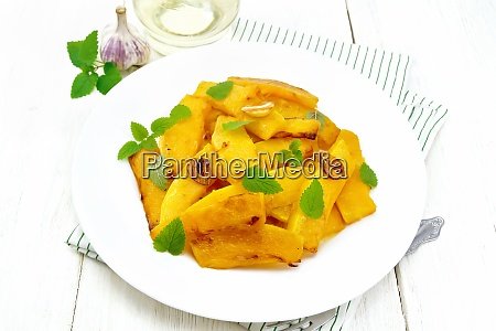 pumpkin with garlic in plate on