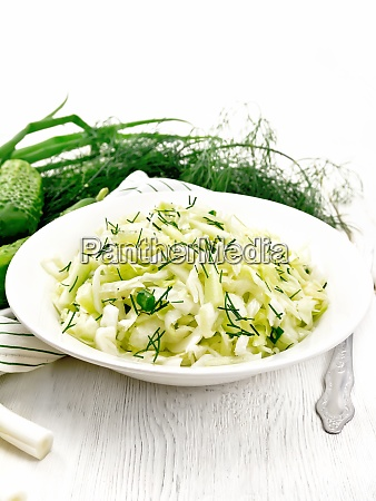 salad of cabbage with cucumber in