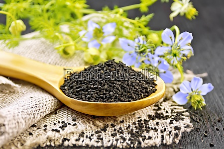 seeds of black cumin in spoon