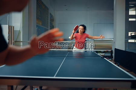 sportive man and woman table tennis