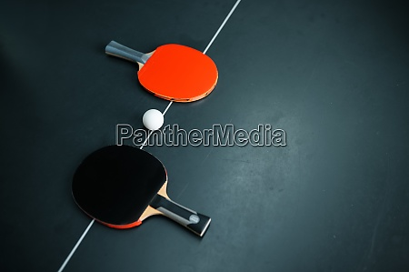 ping pong ball and rackets on