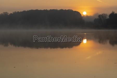 sunrise on jenoi pond near diosjeno