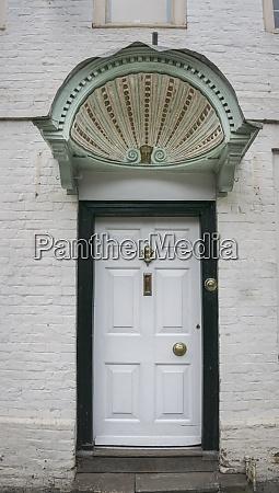 ornate door canopy