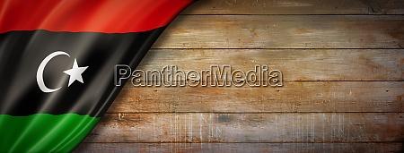 libyan flag on vintage wood wall
