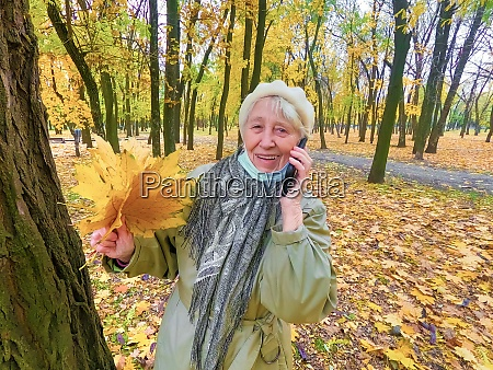 older woman in protective mask and