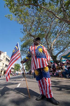 an indian man with malaysia flag