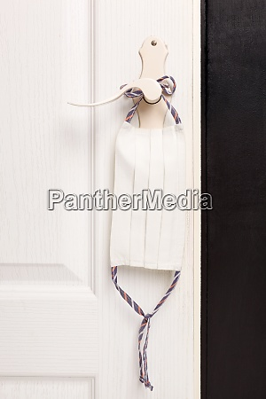 face mask on door handle