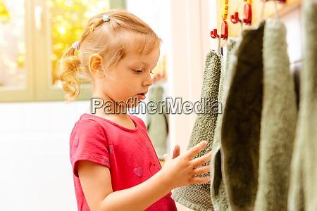 little girl in nursery school using