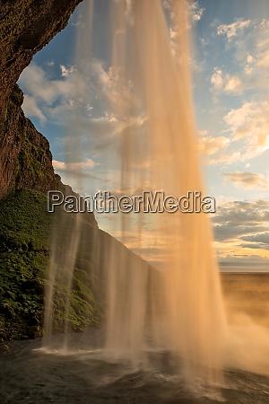 seljalandsfoss waterfall at sunset iceland