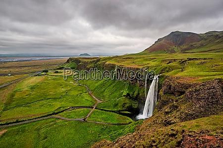 seljalandsfoss waterfall in a cloudy day