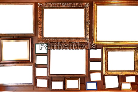 blank picture frames on a wall