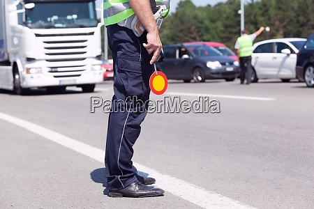 police officer controlling traffic on the