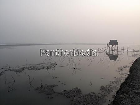 modest straw hut of indian fishermen