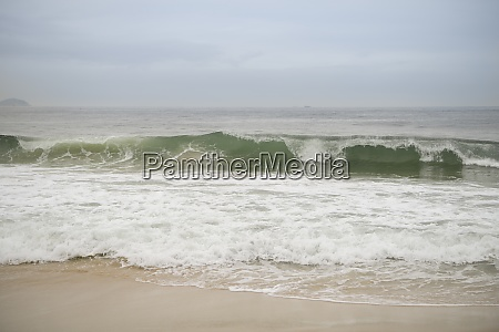 ocean surf on the beach of