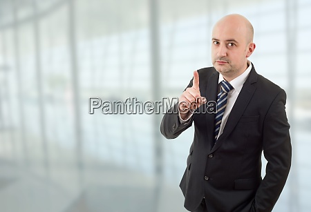 mad business man pointing