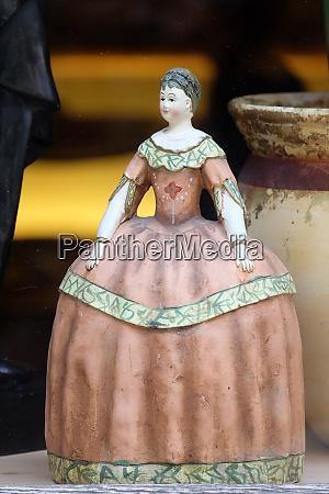 old vintage doll in antique shop