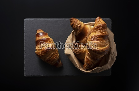 croissant on a black stone plate