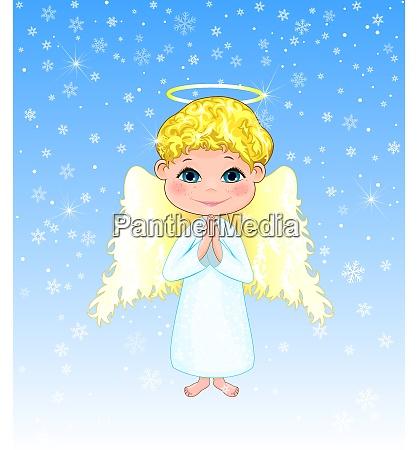 cute boy angel on a winter