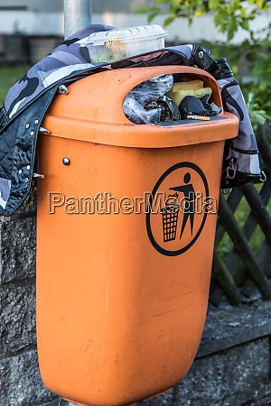 overfilled trash can residual waste