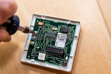 electrician repairs circuit