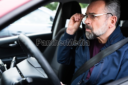 elder male car driver