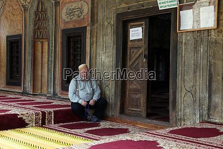 a muslim prays in a mosque