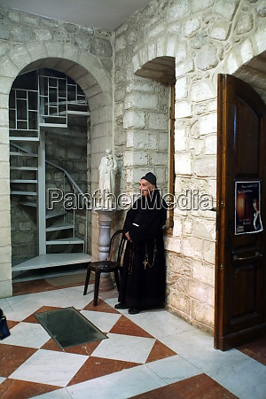 franciscan monk in the church of