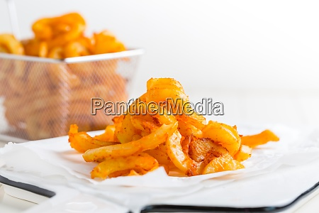 spicy seasoned curly fries ready to