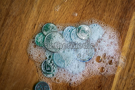 group of coins covered in foam
