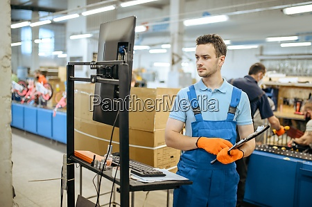 bicycle factory worker poses at assembly