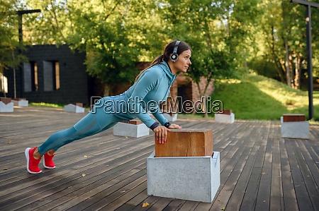 training in park woman doing push