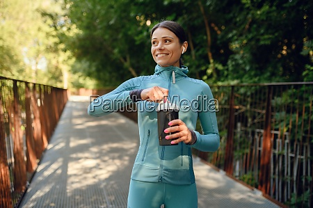 morning training in park woman drinks