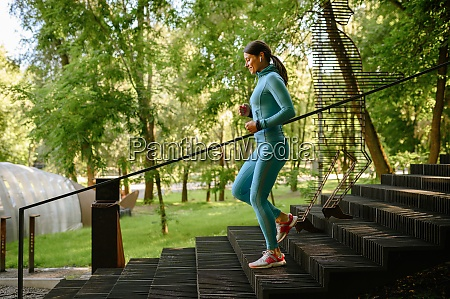 morning workout in park woman jogging