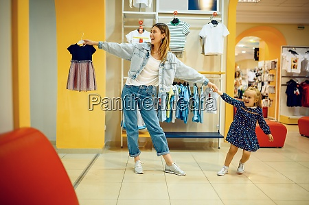 mother and little baby choosing clothes