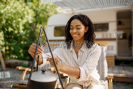 woman cooking near the rv camping